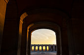 Dusk in Madrid through the arches of the Royal Palace