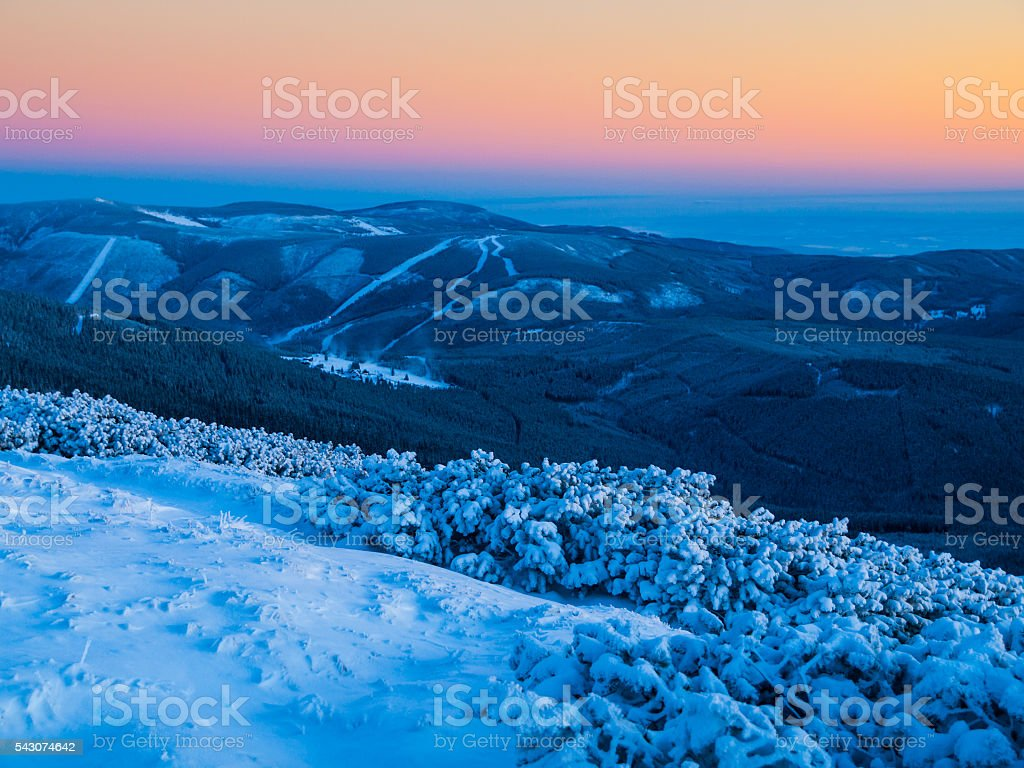 Dusk in winter mountains stock photo