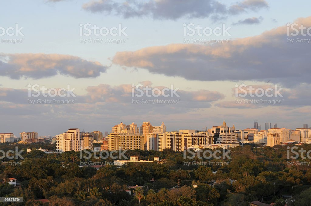 Dusk over a city skyline with clouds stock photo