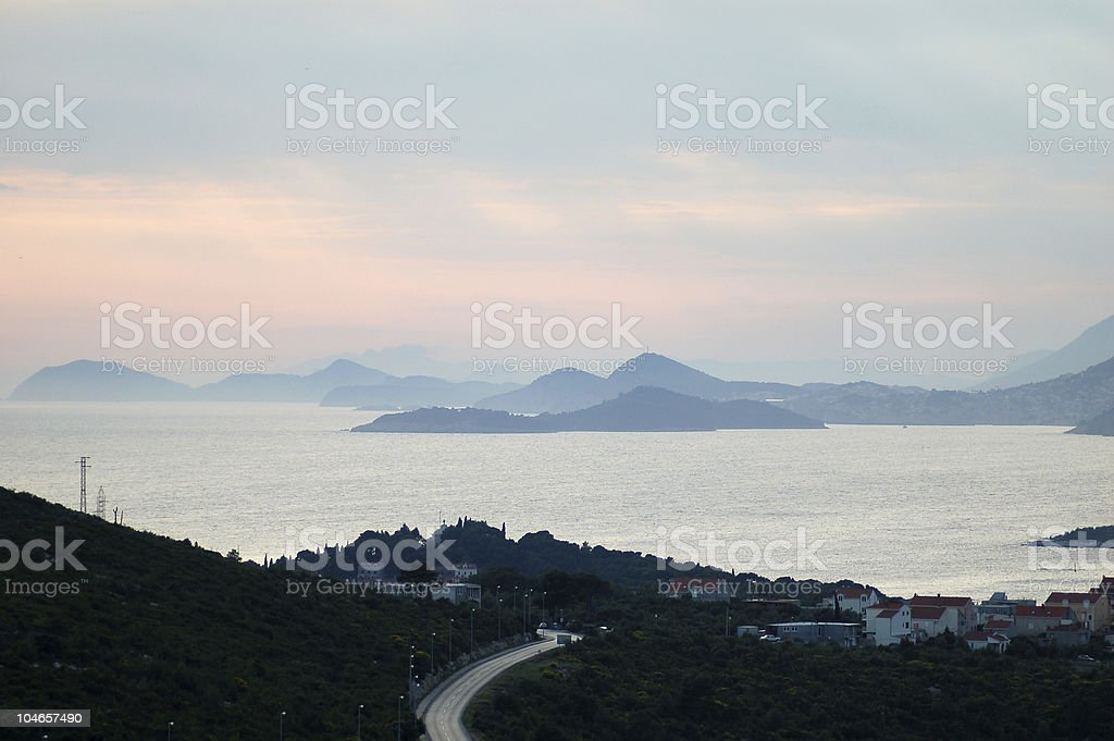 Dusk over beautiful landscape and sea royalty-free stock photo