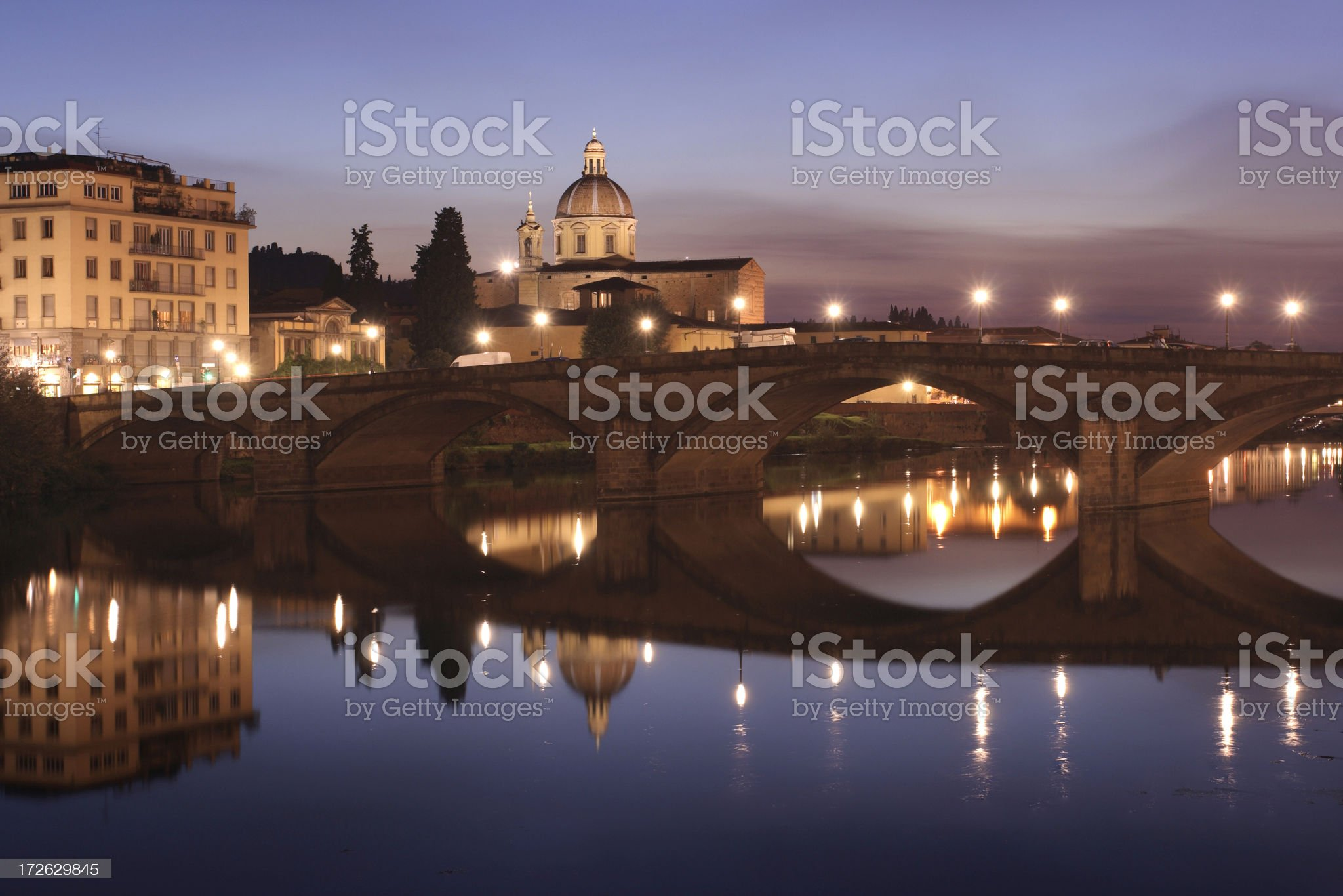 Dusk over bridge on the Arno river in Florence, Italy royalty-free stock photo