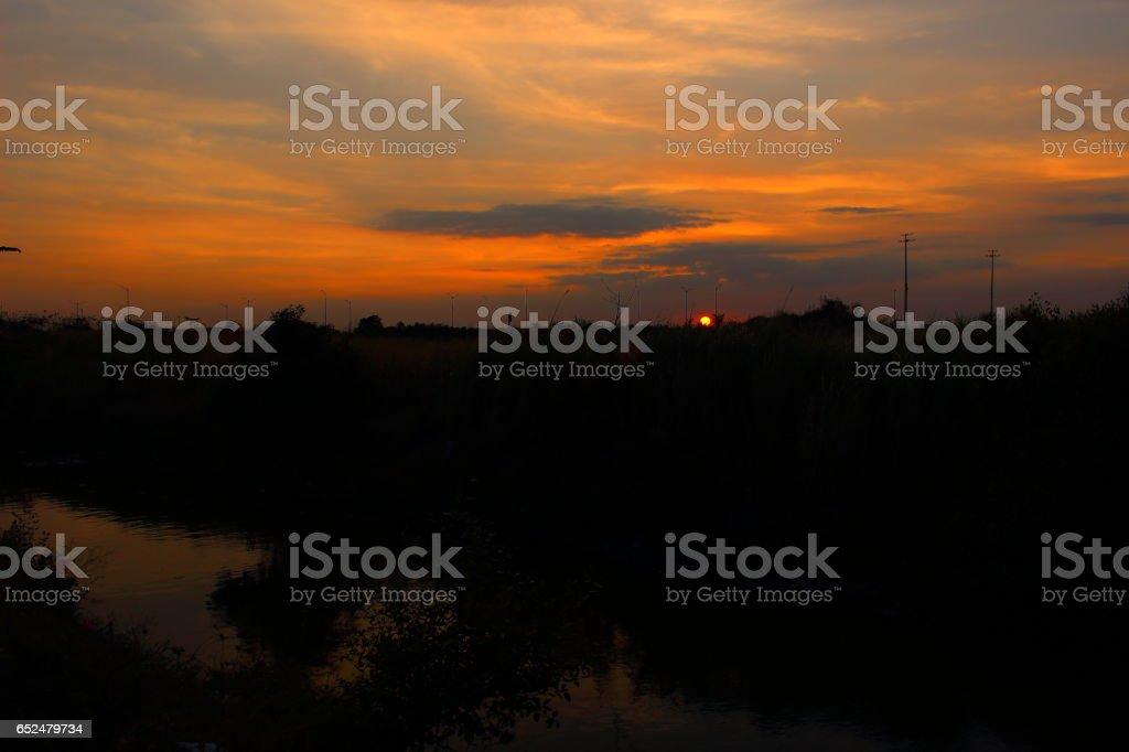Dusk over grassfield stock photo