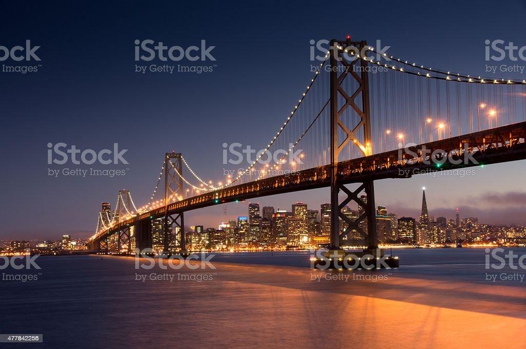 Dusk over San Francisco Bay Bridge and Skyline stock photo