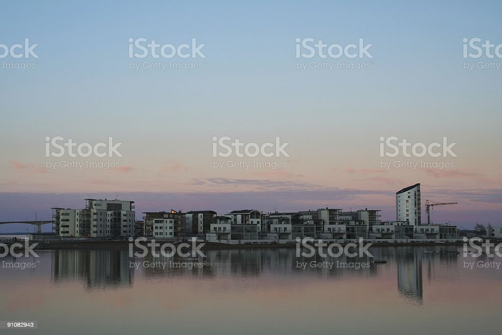 Dusk over town by sea royalty-free stock photo