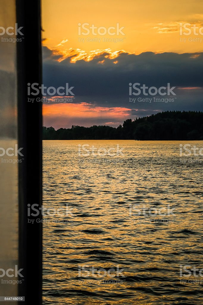 Dusk over vast Danube river surface from a window stock photo