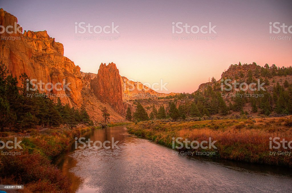 Dusk setting in at Smith Rock and the Crooked River stock photo