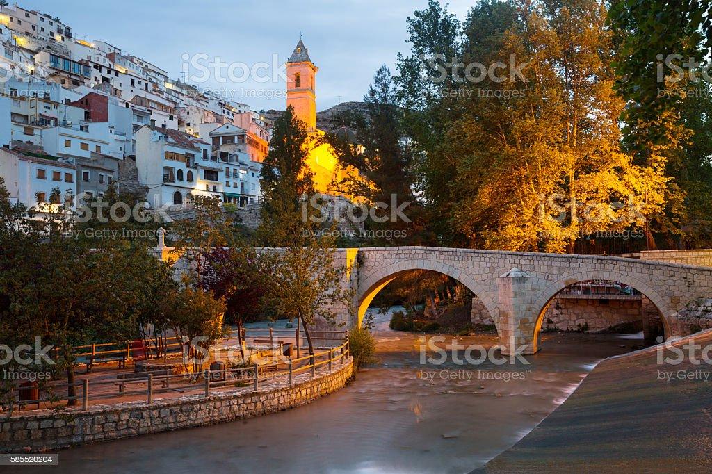 dusk view of Alcala del Jucar with bridge stock photo