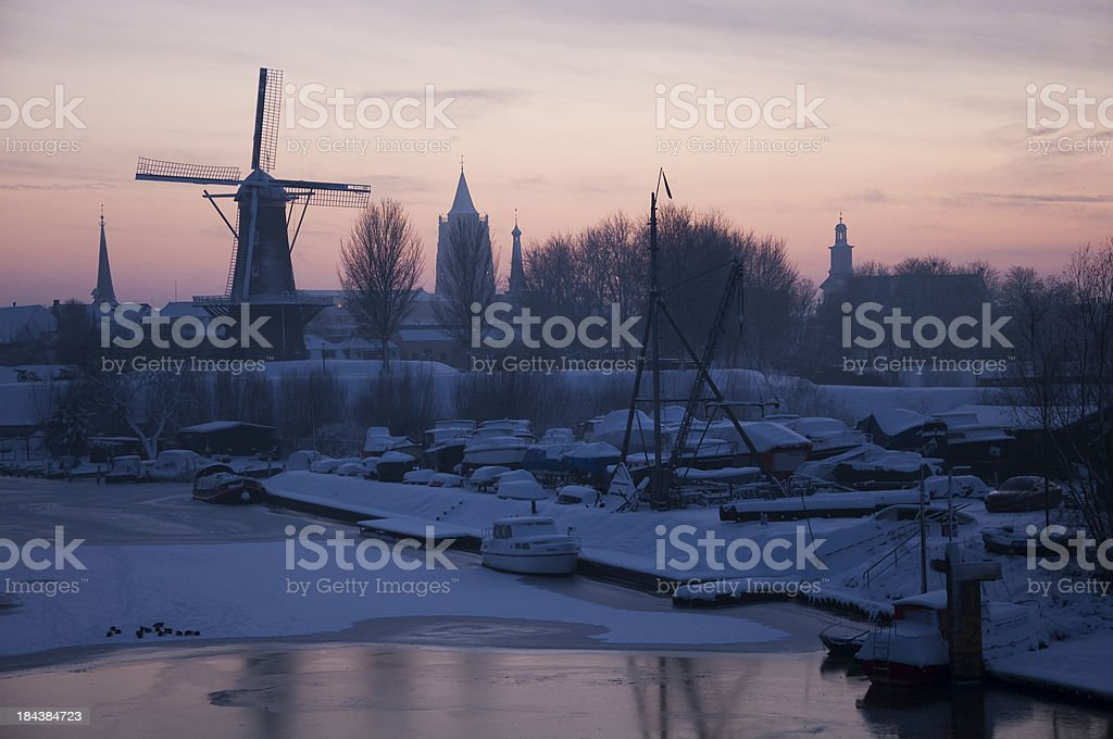 Dusk view of beautiful village in wintertime stock photo