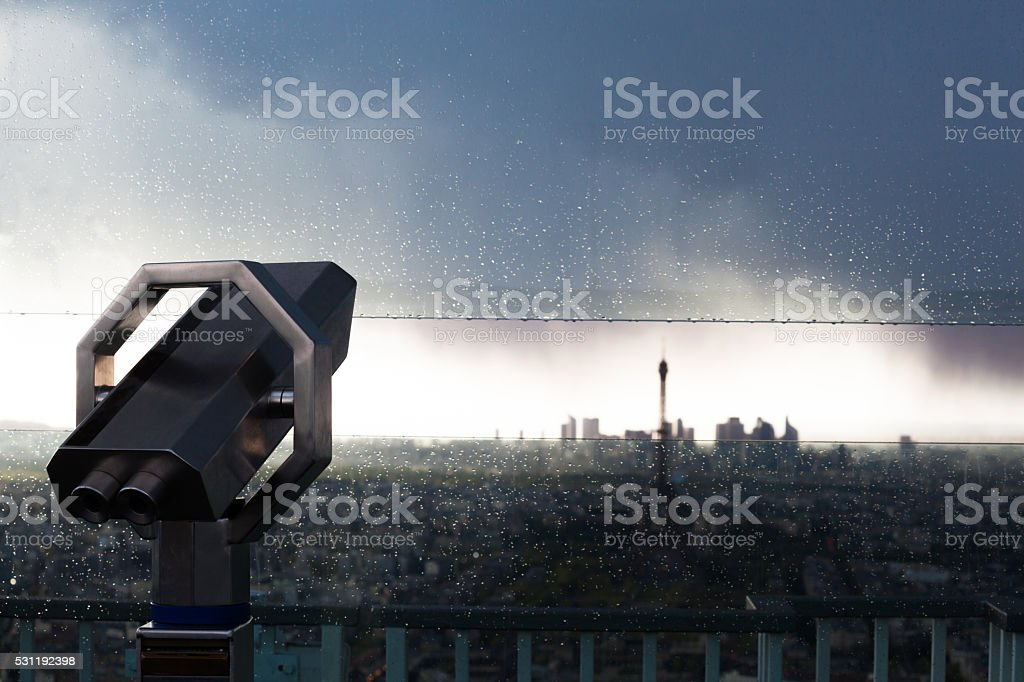 dusk view of telescope Eiffel Tower and La Defense Paris stock photo