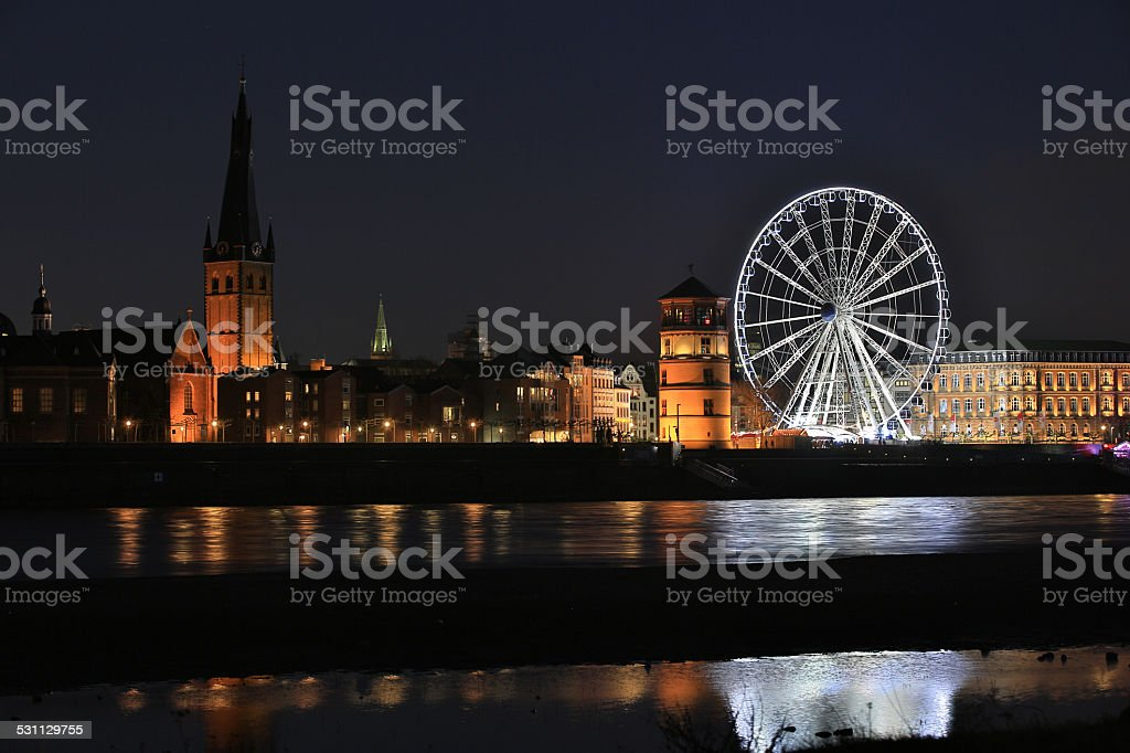 Dusseldorf Old Town nightview with ferris wheel stock photo
