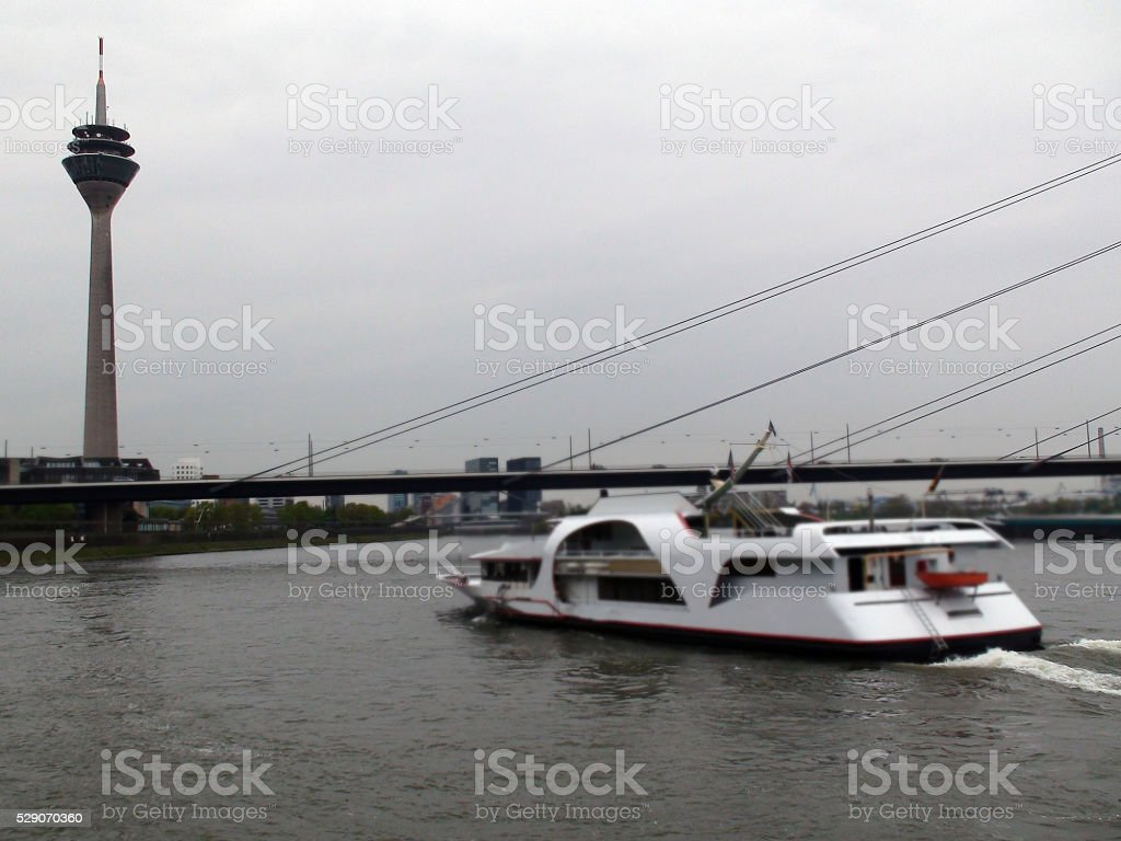Dusseldorf Telecommunication Tower And Tour Boat On River Rhine.Germany.Europe stock photo