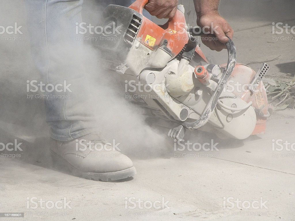 Dust from Cutting Concrete with a Circular Saw stock photo