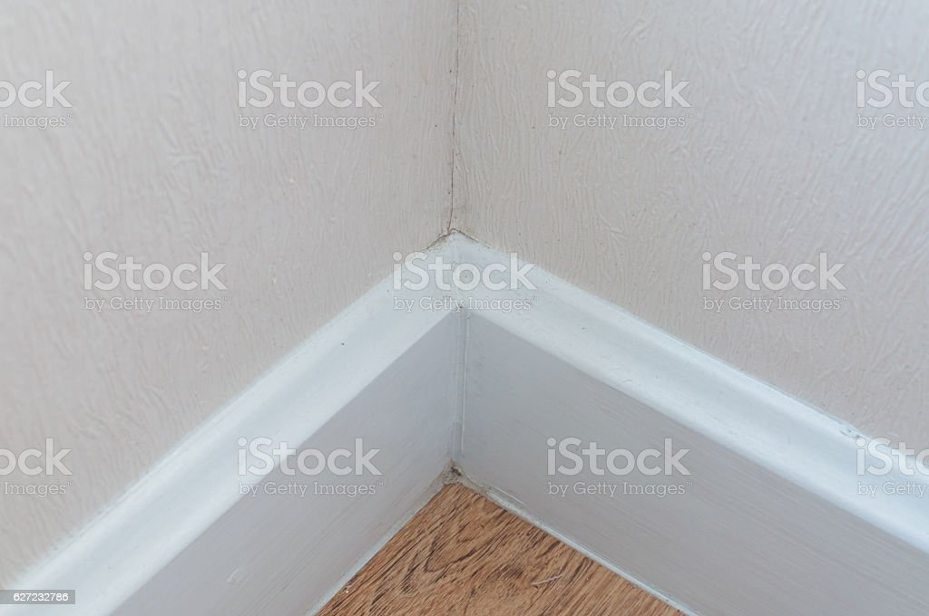 dust in the corner of room wall stock photo