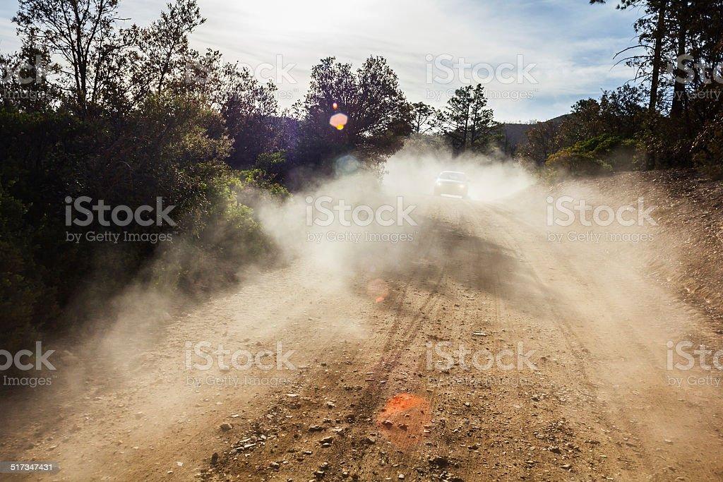 Dust on road stock photo