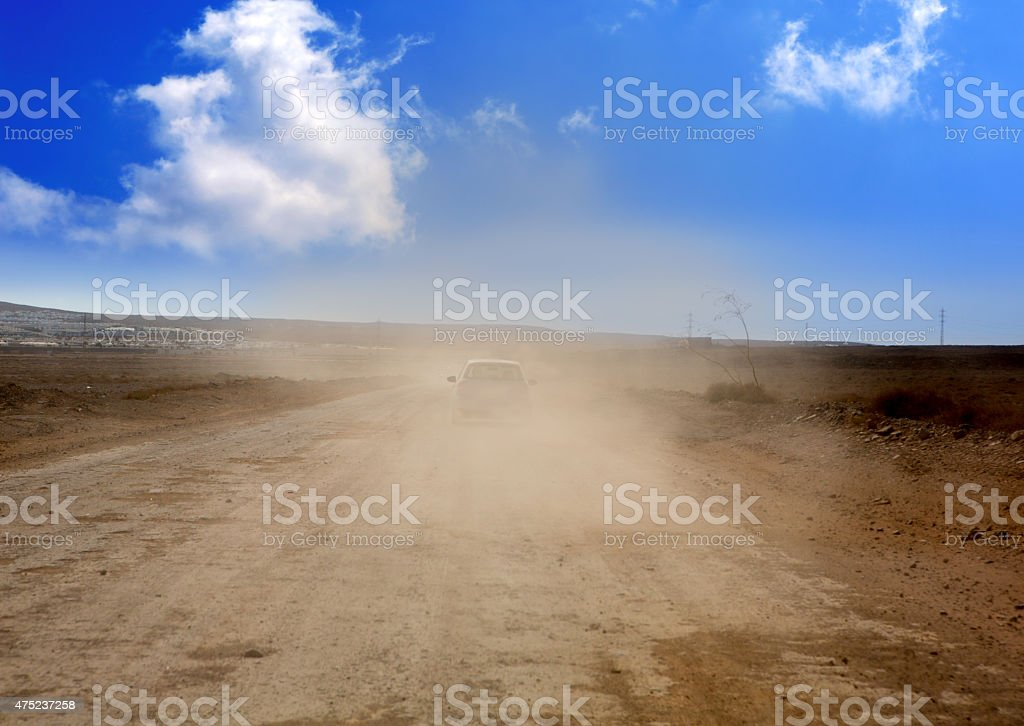 Dust road with car in  brown fog at Lanzarote stock photo