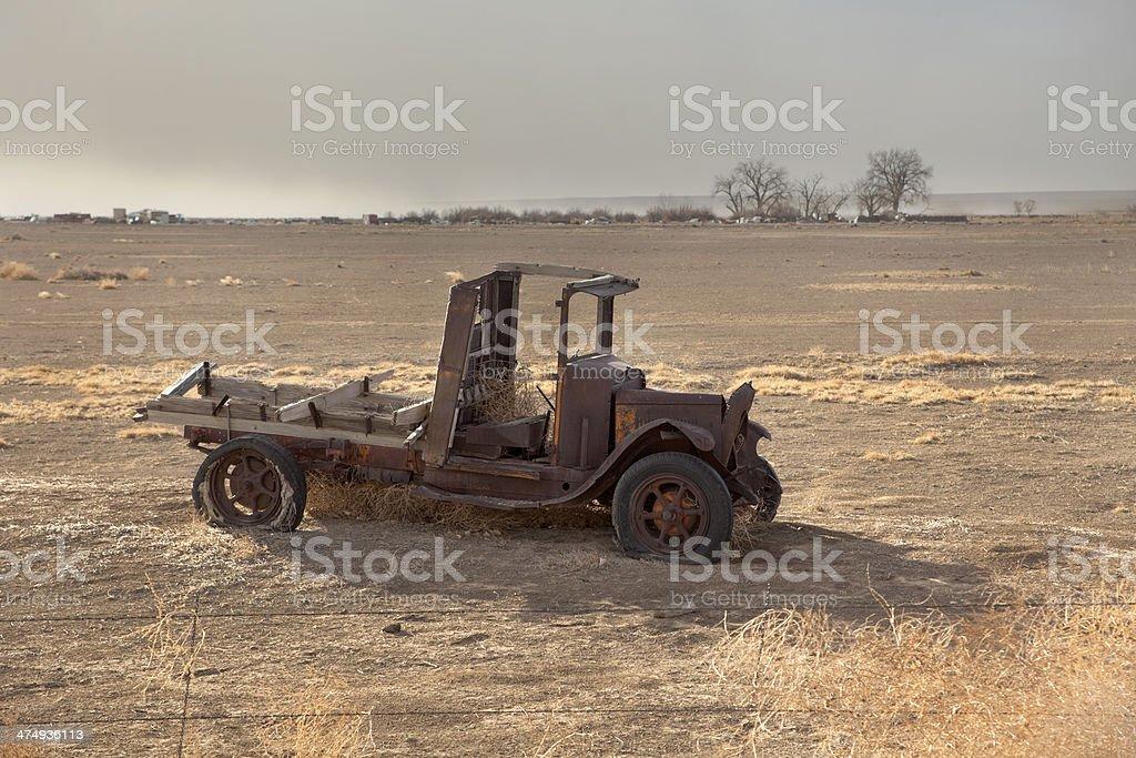 Dust storm blows on Colorado horizon antique depression truck stock photo