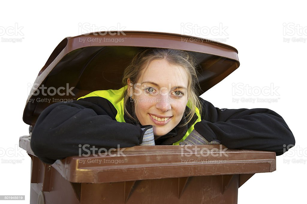 Dustbin containing a young woman looking happy. stock photo