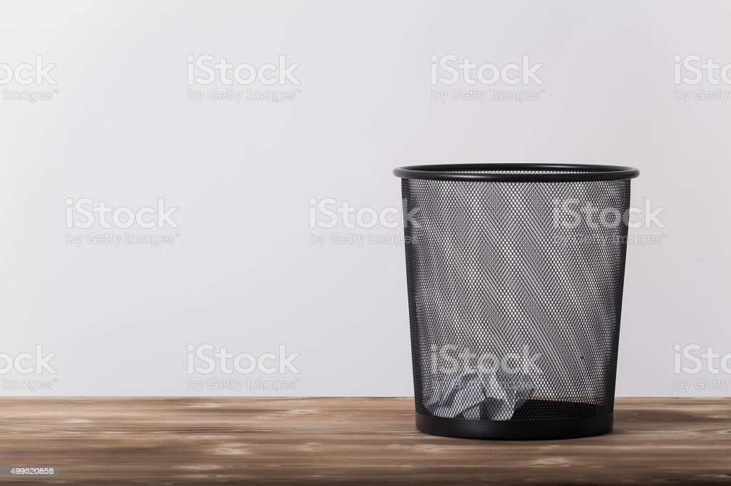 dustbin with crumpled papers stock photo