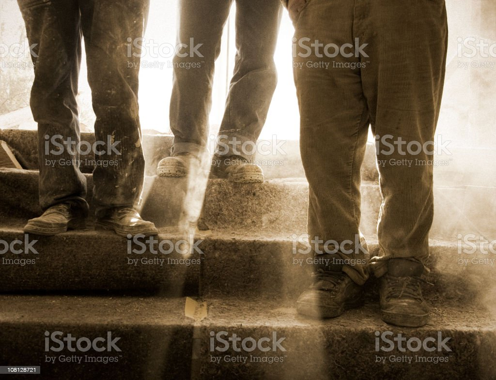 Dusty and Feet at a Construction Site stock photo