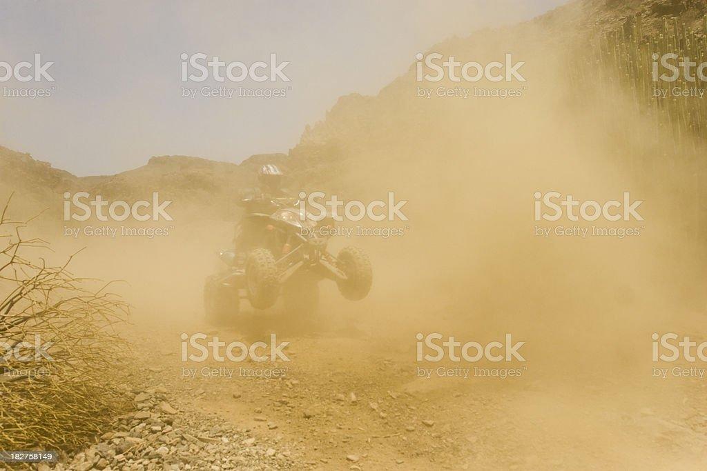 Dusty ATV stock photo