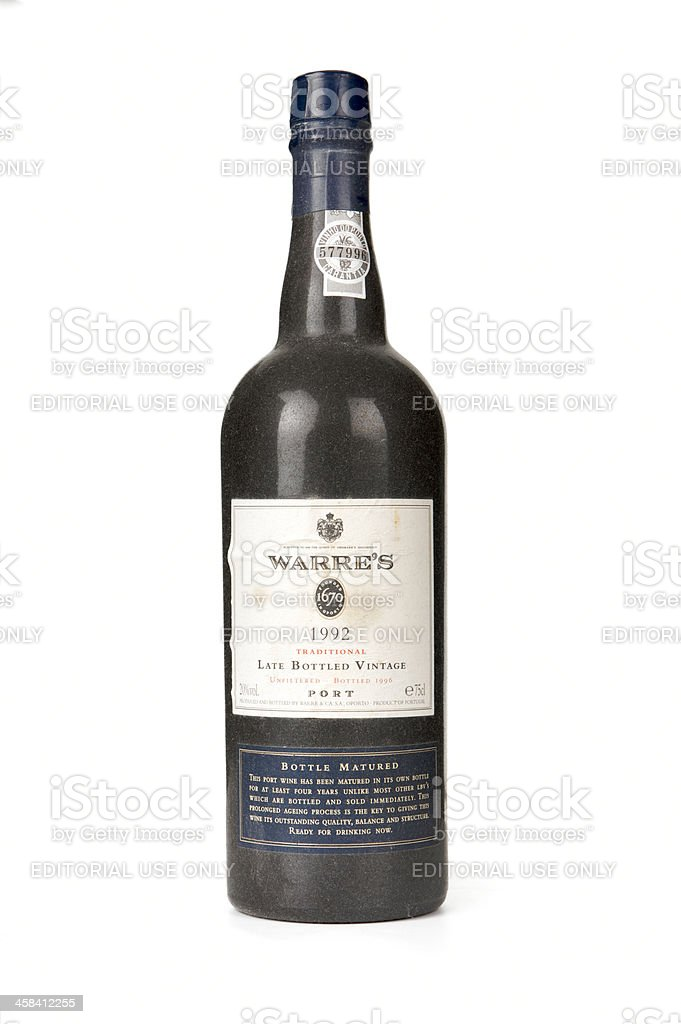 Dusty bottle of Warre's vintage port on a white background stock photo
