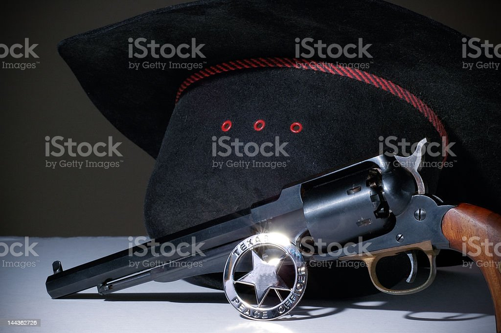 Dusty cowboy hat and gun with Texas badge stock photo