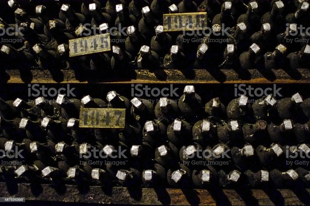 Dusty old bottles of wine royalty-free stock photo
