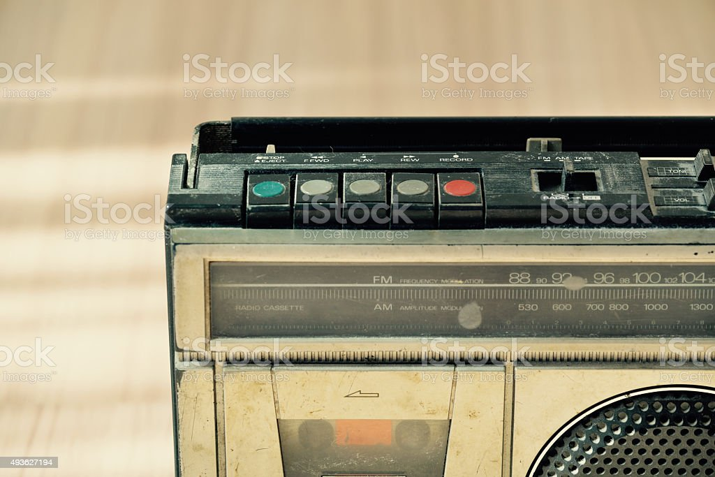 Dusty old radio with one cassette player stock photo