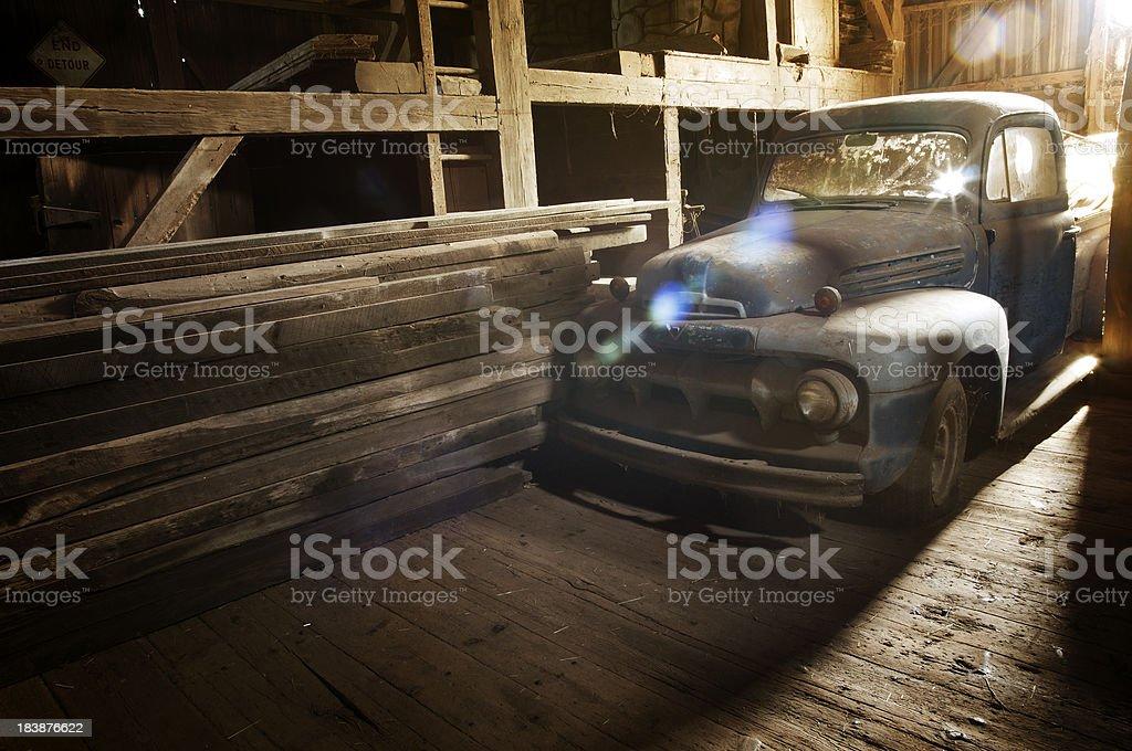 Dusty old truck in barn stock photo