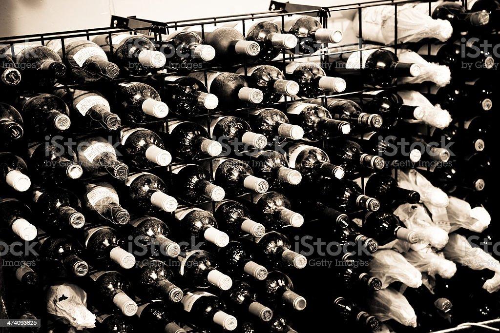 dusty, retro wine rack royalty-free stock photo