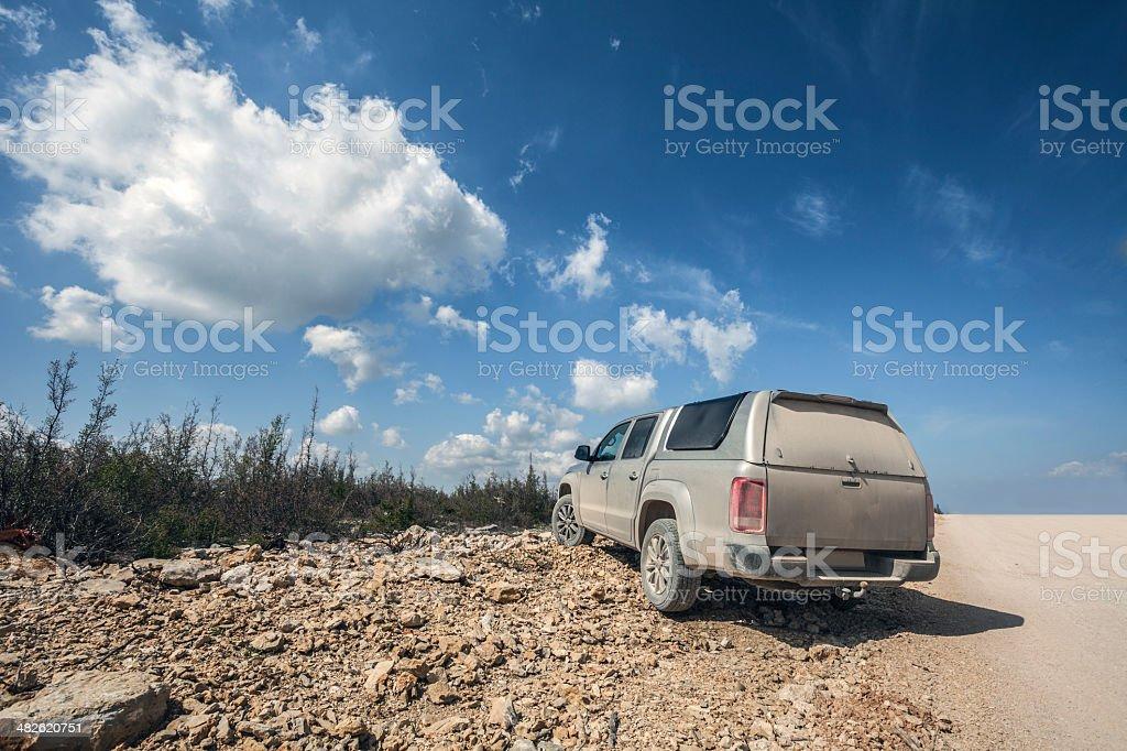 Dusty road vehicle royalty-free stock photo
