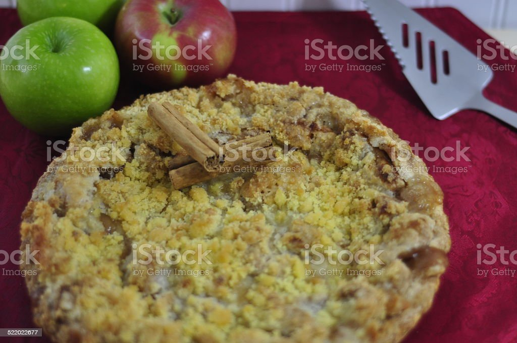 Dutch Apple Pie with Apples, Cinnamon and Pie Server stock photo