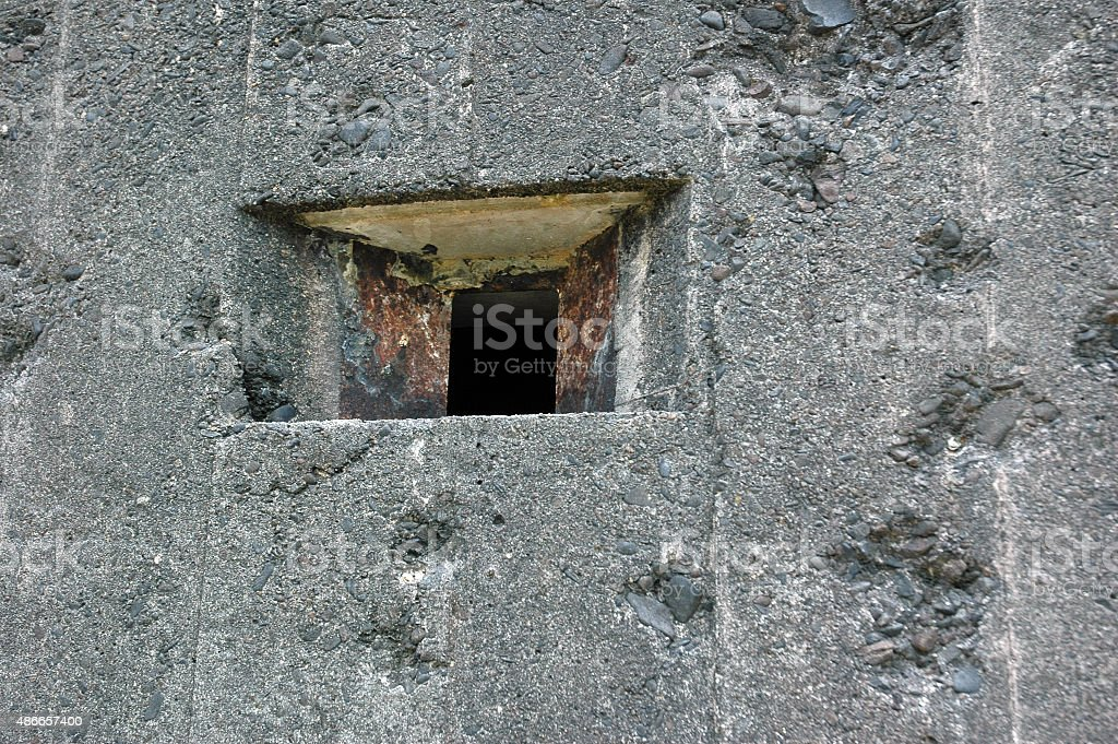 cannon holes on Dutch army military defense bunker during the second...