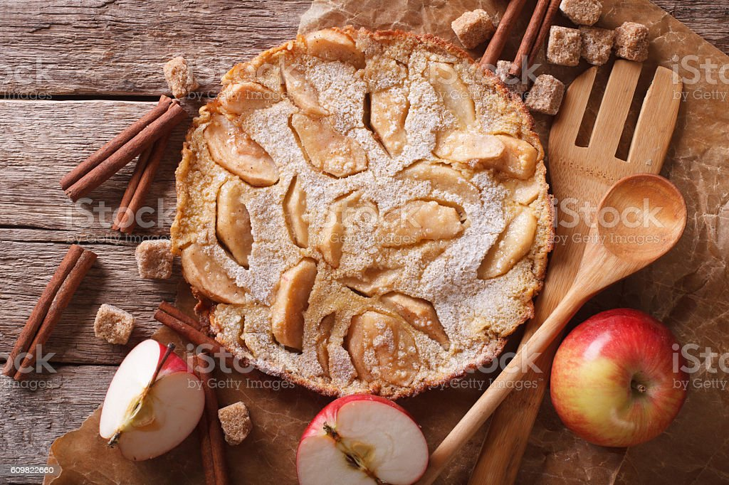 Dutch baby pancake with apple on a paper closeup. horizontal stock photo