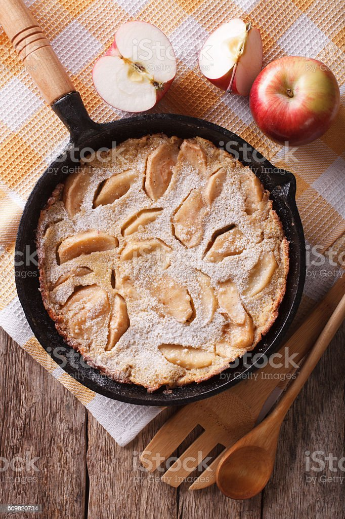 Dutch baby pancake with apples in a pan closeup. vertical stock photo