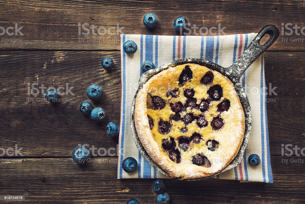 Dutch Baby pancake with blueberrie stock photo
