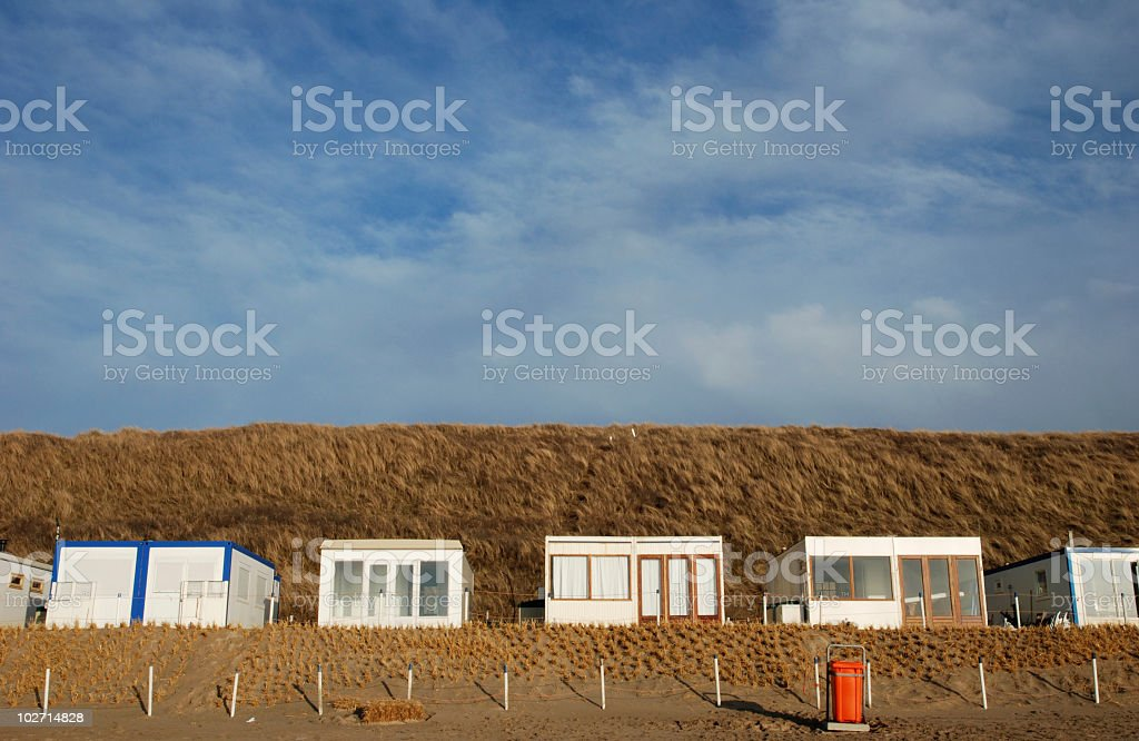 Dutch beach cottages stock photo