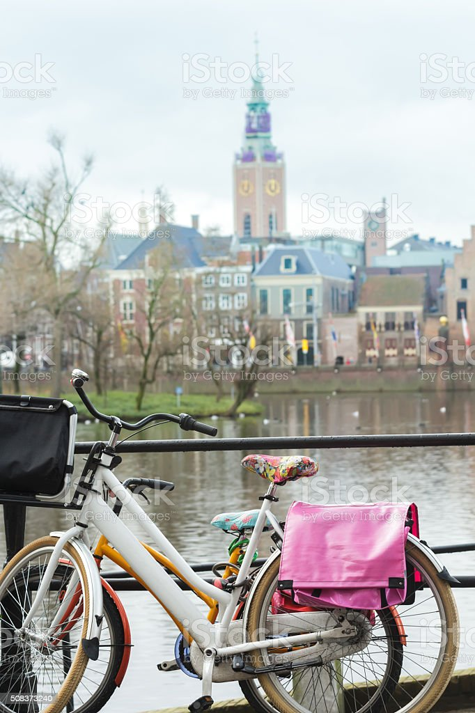 Dutch bikes at Court Pond and Grote of Sint-Jacobskerk background stock photo