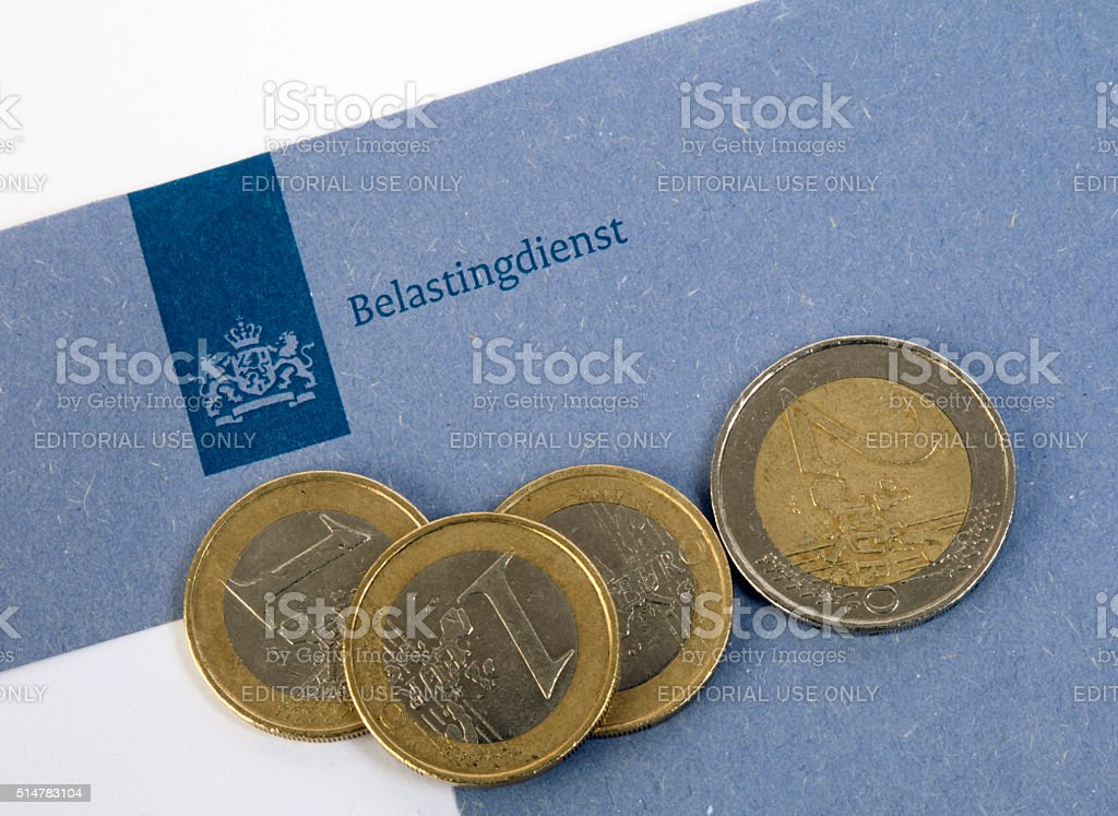 dutch blue tax envelope of the tax office  euro coins stock photo