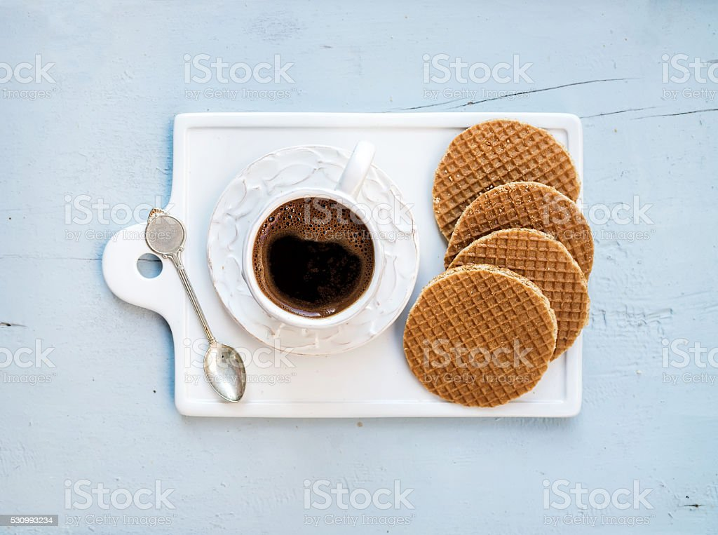 Dutch caramel stroopwafels and cup of black coffee stock photo