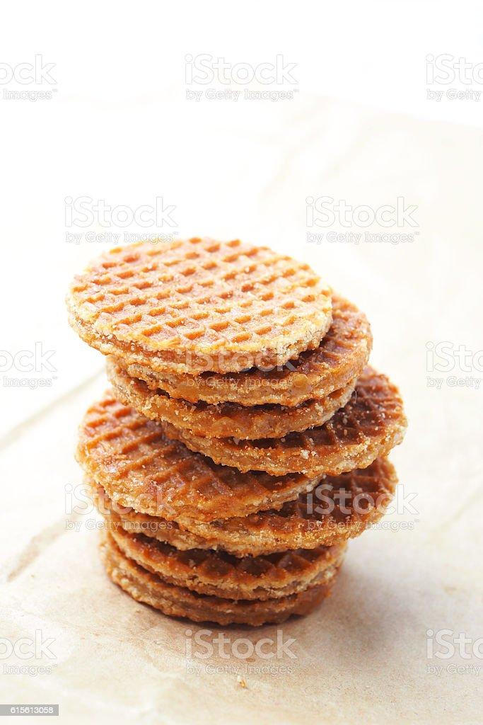 Dutch caramel waffles on a waxed paper. stock photo