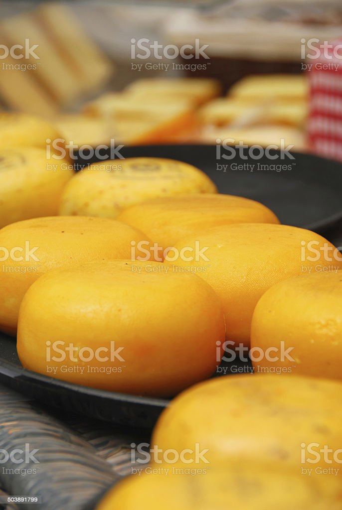 Dutch Cheese laying on a market stall. royalty-free stock photo