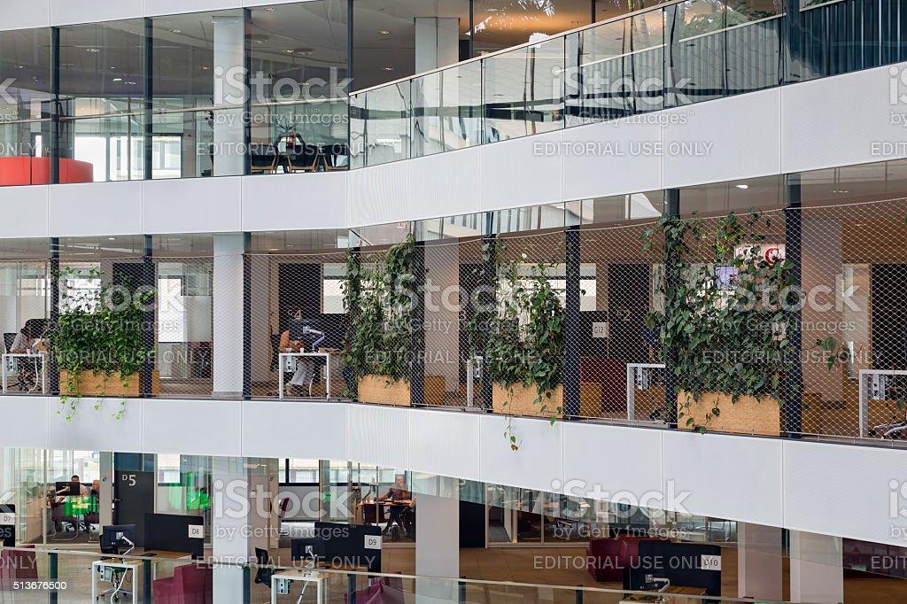 Dutch City hall Utrecht with officials working behind their desk stock photo