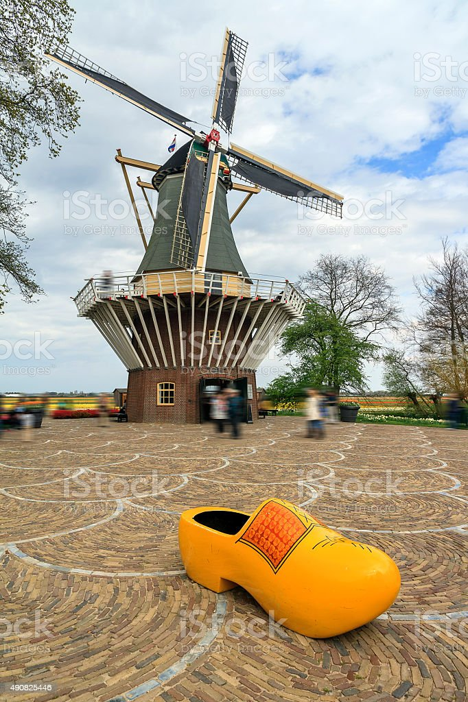 Dutch clog and windmill stock photo