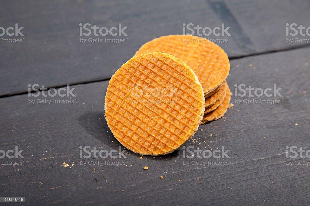 Dutch cookie stroopwafels on black wooden background stock photo