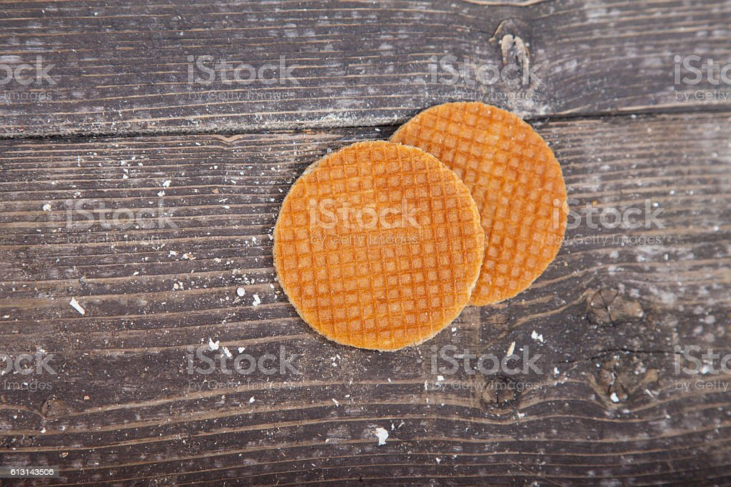 Dutch cookie stroopwafels on brown wooden background stock photo