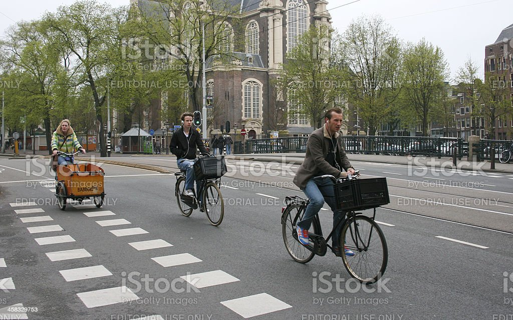 Dutch cyclists in Amsterdam royalty-free stock photo