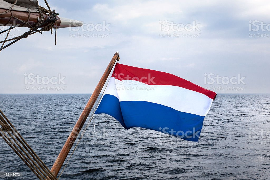 Dutch flag at the stern of a sailing ship stock photo