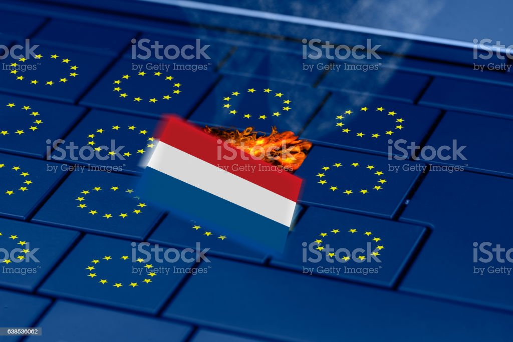 dutch flag exploding in a pc keyboard during dutch elections stock photo