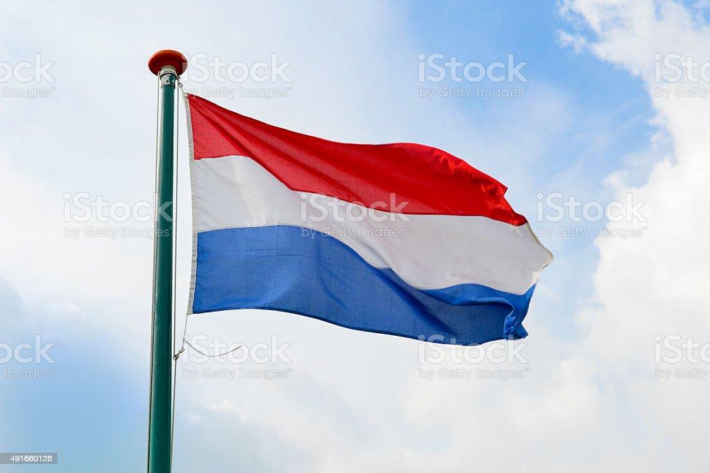Dutch flag waving in the air stock photo